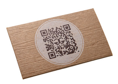 photo of letterpress business card with wood-grain and  QR code on chip board